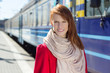 portrait of beautiful woman waiting for train on the platform