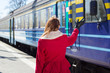 woman waving hand on the platform