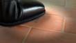 Sigaretta spenta con la scarpa sul pavimento
