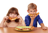 happy little girl and boy eat pizza