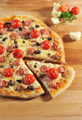 Peperoni Pizza with cherry tomatoes and olives