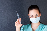 Nurse or doctor with syringe and mask