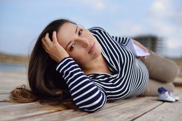 beautiful pregnant woman on the sea coast