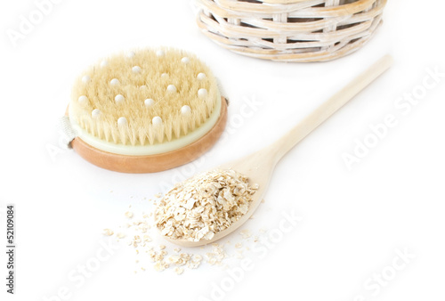 Oatmeal and brush on white background