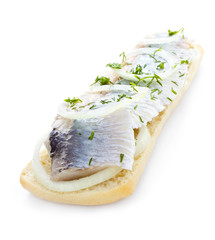 Sandwich with herring, onions and herbs, isolated