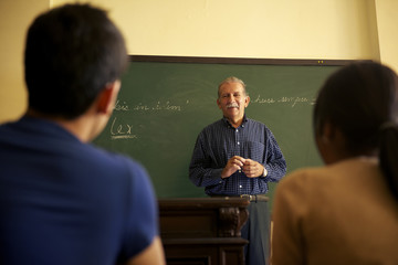 School people, professor talking to students during lesson in co