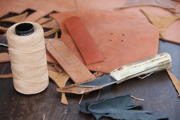 roll of Twine and cutter for the craftsmanship of leather to pro