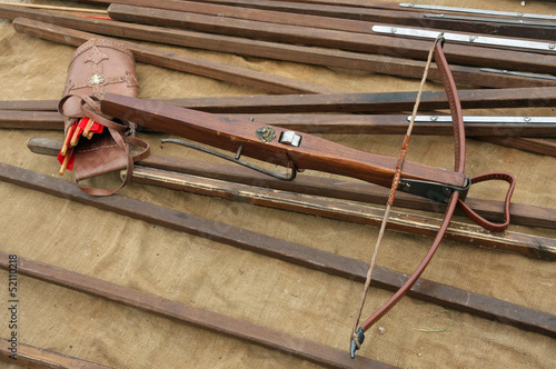 wooden crossbow with arrows and other ancient