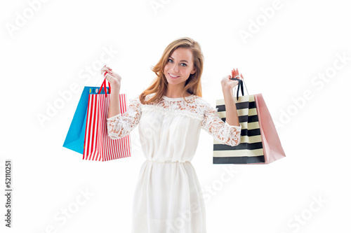 Beautiful shopping woman holding shopping bags