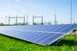 solar panel against high voltage towers - 52110487
