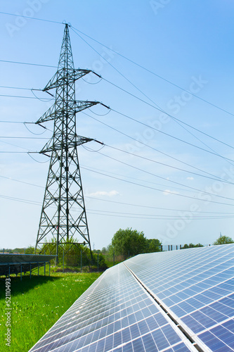 solar panel against high voltage towers