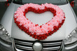 wedding car with heart from flowers