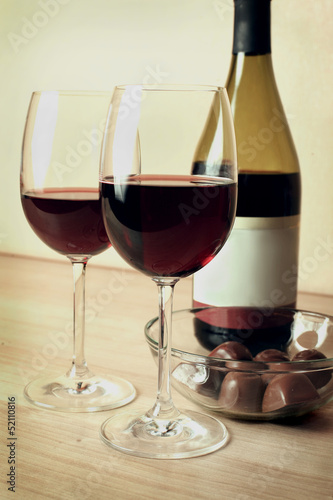 two glasses of red wine and chocolates