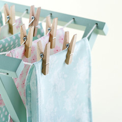 Closeup of laundry drying on wooden drying rack