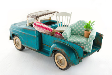 Green toy truck for moving houses