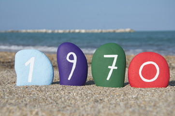 1970 on colourful stones over the sand