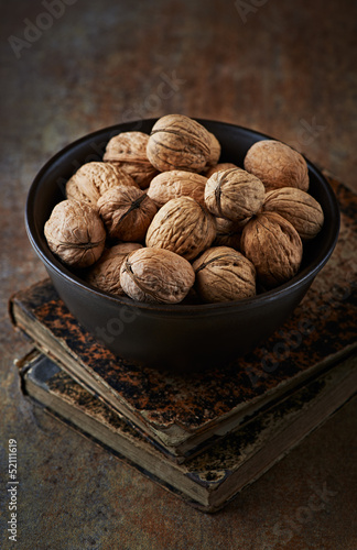 Still life with walnuts in a ceramic bowl