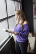 Young Woman in a Purple Shirt Reading a Book