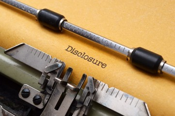 DIsclosure form on typewriter