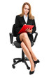 Businesswoman sitting on a chair isolated on white