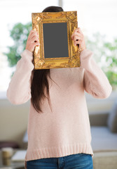 Woman Hiding Face With Picture Frame