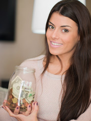 Woman Holding Jar Of Money