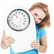Woman is keeping to a diet shows a pair of scales