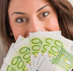 Happy Woman Holding Euro Currency