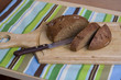 Wooden cutting board with sliced bread