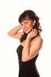 Beautiful woman wearing elegant black dress isolated