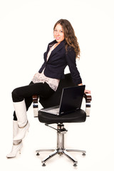 Beautiful businesswoman in a chair with laptop