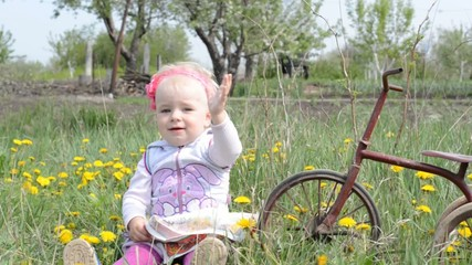 Cute baby on bicycle. Dolly shoot.