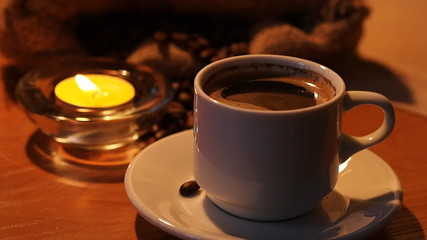 Romantic background with a cup of coffee and candles