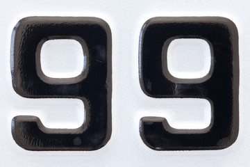 car plate number ninety-nine black lettering on white background