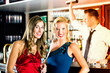 Young women and bartender in club or Bar