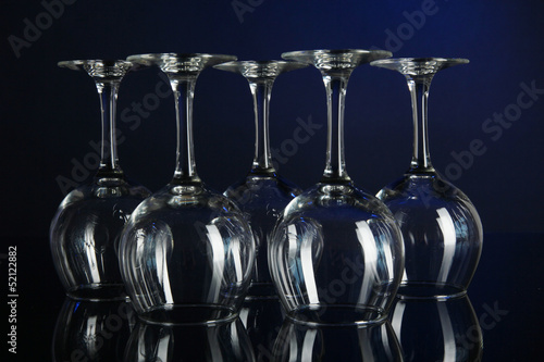 Glasses on dark blue background