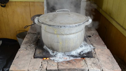 zoom out big pot boil water flow burn old rural old rural stove