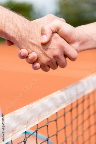 Handshake at a tennis match