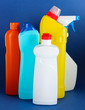 Different kinds of bath and toilet cleaners and colorful