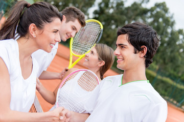 Tennis players handshaking
