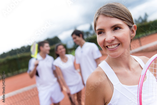 Woman at a tennis court