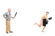 Middle aged man with baseball bat shouting at a young naked man