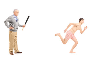 Angry man chasing a naked man