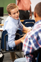 Two Male Pupils Talking In Class