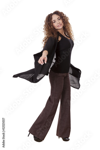 Woman spins with long black shirt flowing behind her.