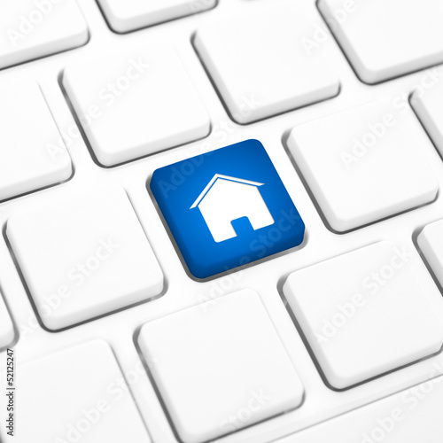 Home or real estate concept, house key on a keyboard