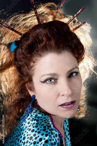 Fashion redhaired model portrait. Hairstyle
