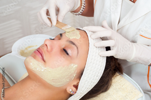 Beautiful young woman with natural facial mask