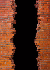 Broken into a brick wall with a black field