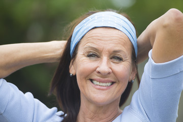 Happy smiling mature woman outdoor